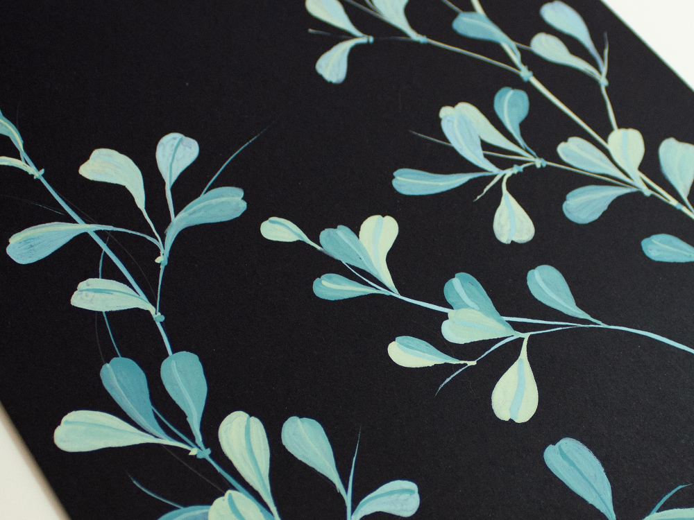 Bright leaves on black paper